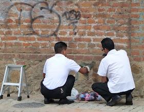 Photo: Removing graffiti