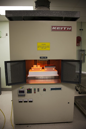 The heat shield tiles are in a Keith thermal automation oven in the Thermal Protection System Facility at NASA's Kennedy Space Center in Florida.
