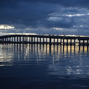 Eau Gallie Causeway by Keith Heinly - Buildings & Architecture Bridges & Suspended Structures ( clouds, water, reflection, florida, bridge )