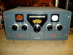 Photo: Central Electronics 200V 100 W AM/PM/CW/SSB transmitter from ca. 1960.  Note that there's no final tuning controls; it's tune-less!  Just twist the VFO and hit the key.  The white circle in the upper right is an oscilloscope, used to monitor transmission quality on the air.