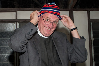 Photo: Rev. Dr. Tim Quill receiving a hat made by members of the Gutnius Lutheran Church.
