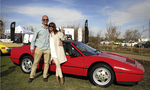 Zia and Glenn Wort in front of her winning 1989 Ferrari 328 GTS.