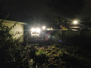 Photo: Late night parking pad prep. Neighbor came over with a bobcat after work.