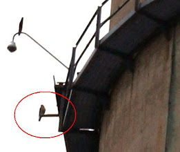 Photo: There it is.  A pair of falcons uses a nesting box on the stack at this level.