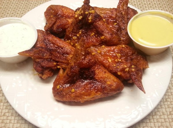 Finally, place each chicken wing individually into the skillet and coat with sauce. Plate...