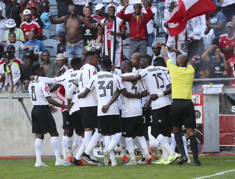 Tshegofatso Mabasa celebrates with teammates after scoring his second goal.