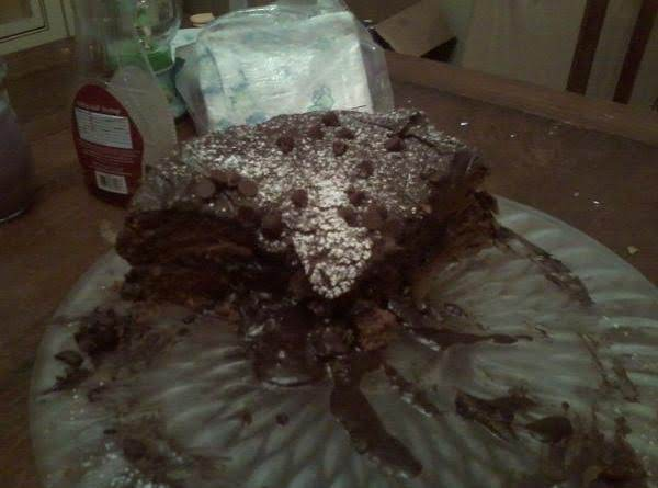 I Topped This Rich Chocolate Cake With A Confectioner Sugar Dusting And Sparingly Sprinkled Milk Chocolate Chips On Top! This Is What's Left! I Posted This Recipe At My Families' Request And After Very Full Bellies!