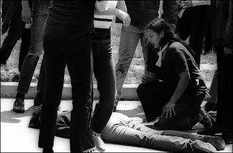 Photo: Mary Vecchico at the body of Jeffrey Miller.