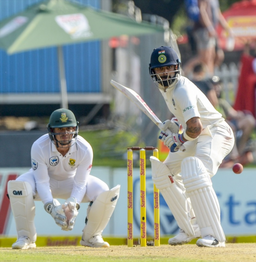 Captain Virat Kohli of India and wicketkeeper Quinton de Kock of South Africa during day 2 of the 2nd Sunfoil Test match between South Africa and India at SuperSport Park on January 14, 2018 in Pretoria.
