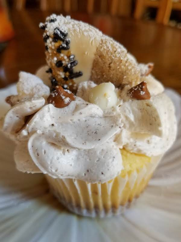 Snickerdoodle Cookie Cupcake. Yummy Cookie Crust On The Bottom. Cookie & White Chocolate And Cinnamon Chips On Top.