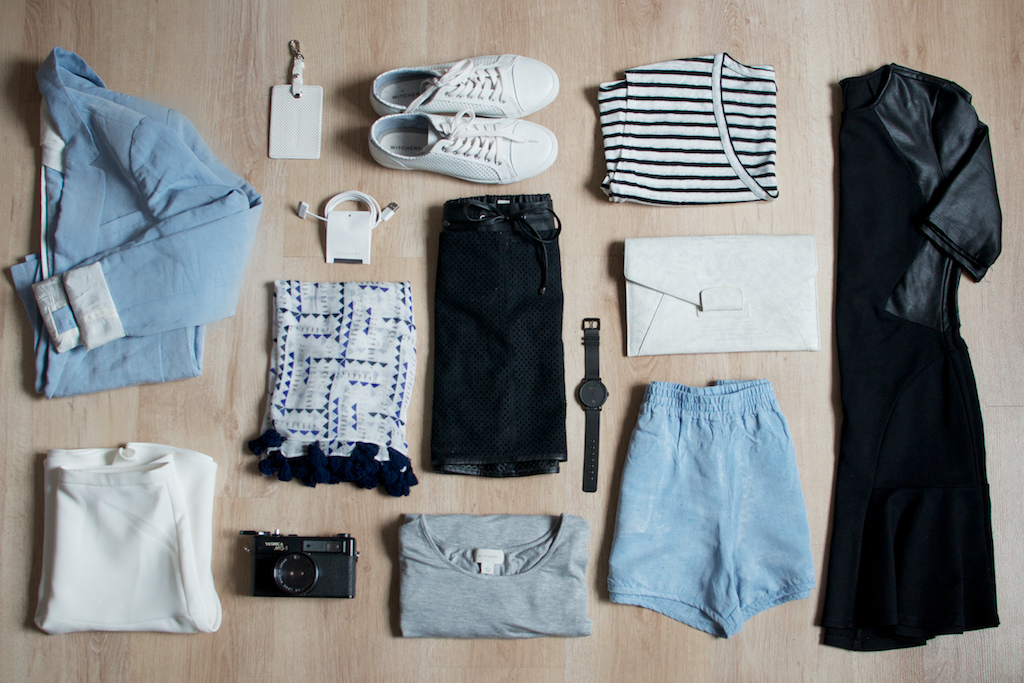 styled clothing laid out for packing