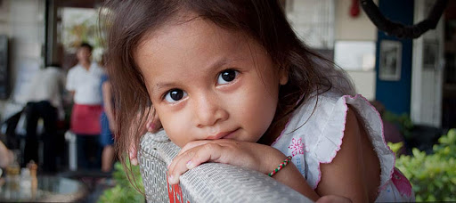 A young local girl in Phnom Penh, Cambodia.
