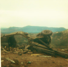 Photo: Remnants of howitzer following sapper attack.  Presume looking in a W/SW direction.