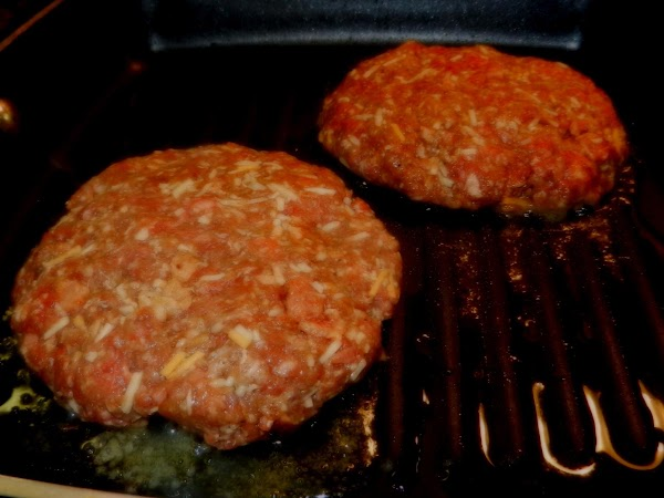 In a stove top grill pan, over medium-high heat, cook the burgers in a...