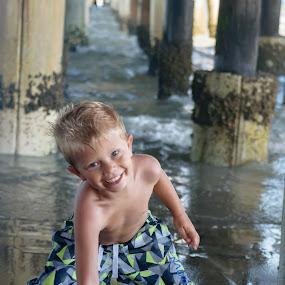 Future Football Star  by Dory Formiller - Babies & Children Children Candids ( water, football, florida, pier, four, beach, smiles,  )