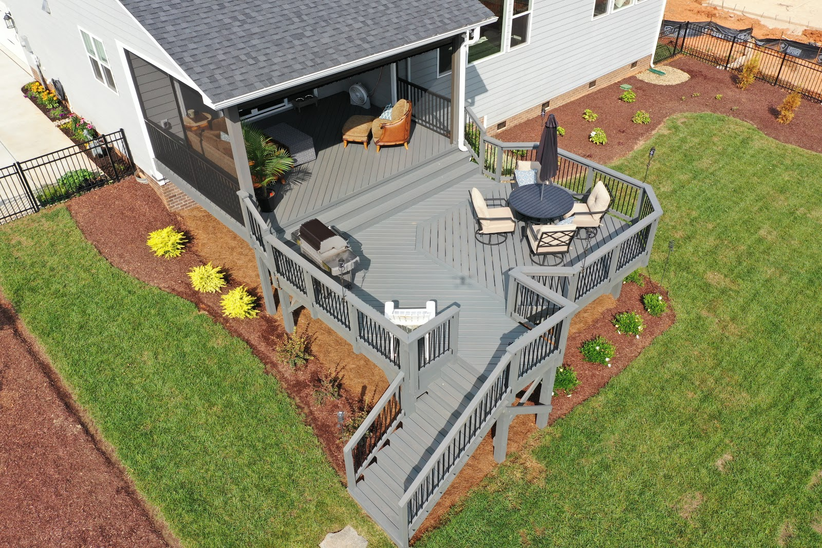 hybrid covered porch and deck with mowed yard