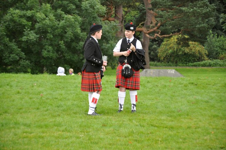 Two boys wearing kilts