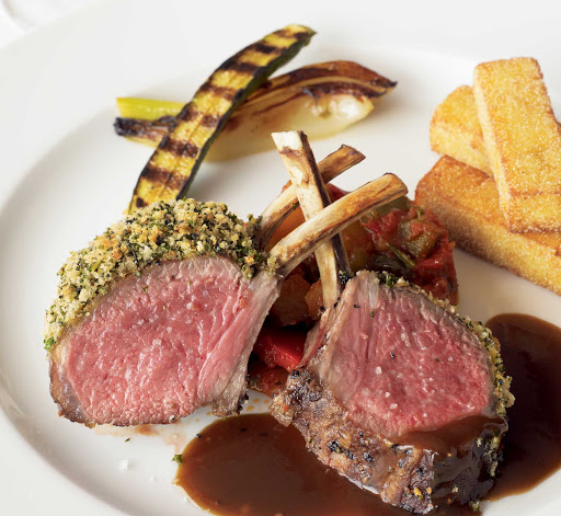 Oceania-lamb.jpg -  Rack of lamb, just one many exquisite entrees available on Oceania, the cruise line for foodies.