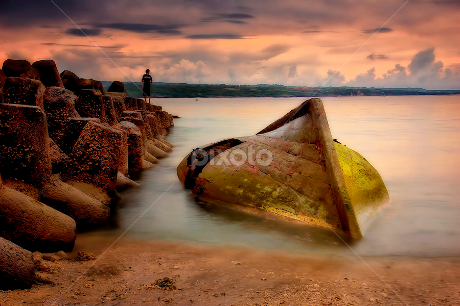 .:: retired and lonely ::. by Setyawan B. Prasodjo - Landscapes Sunsets & Sunrises ( bali, waterscape, kelan beach, moss, leissure, seascape, game, beach, travel, boat, landscape, over, sunset, seafood, wave, sunrise, rocks )