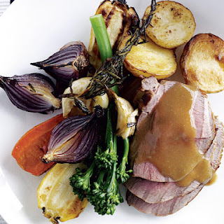Roasted Lamb with Vegetables and Gravy.