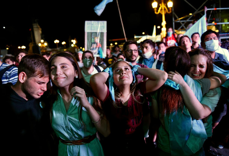 Demonstrators in favour of legalising abortion react after the senate passed an abortion bill, in Buenos Aires, Argentina, December 30 2020. Picture: REUTERS/MARTIN VILLAR