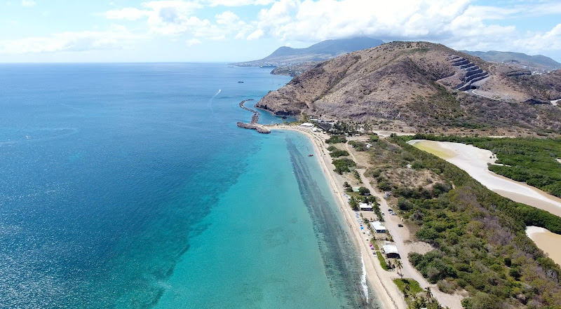 Drone image of the narrow beach and coastline of Frigate Bay in St. Kitts, looking north.