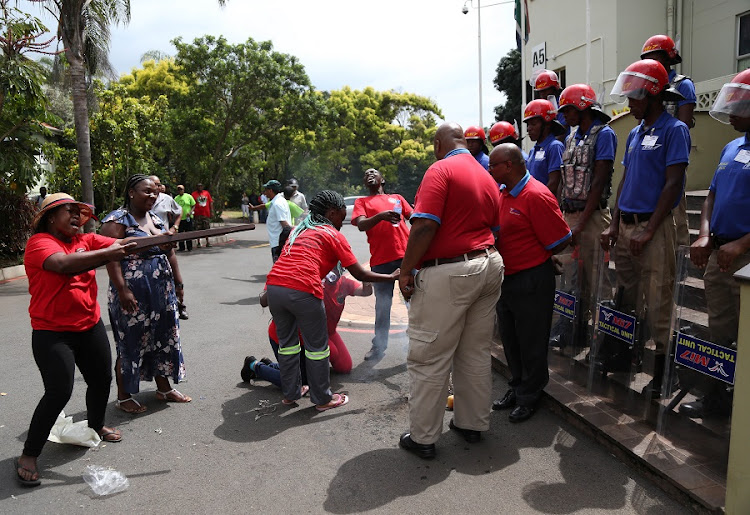 Striking DUT staff protest outside the Vice Chancellors office in Durban as Mi7 security block access to the building. Picture: JACKIE CLAUSEN