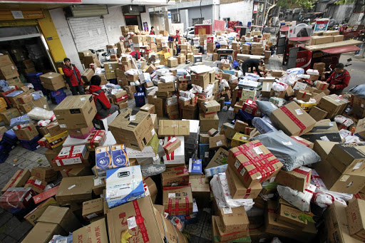 Employees sort boxes and parcels at a JD.com logistics station in Xi'an, Shaanxi province, China.  Picture: Reuters