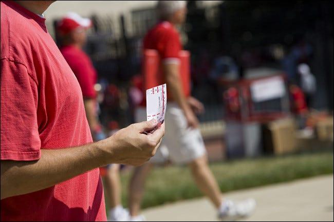 A scalper with a sports ticket.