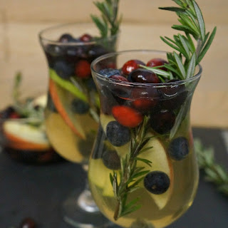 Holiday White Cranberry Sangria with Rosemary.