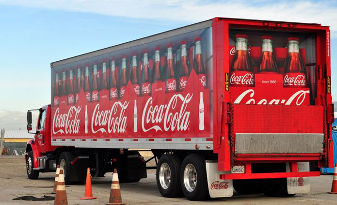 Coca Cola truck looking like it is carrying giant bottles