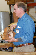 Photo: Chuck shows some of the parts that he likes to the membership, including the burning patterns and wood characteristics.
