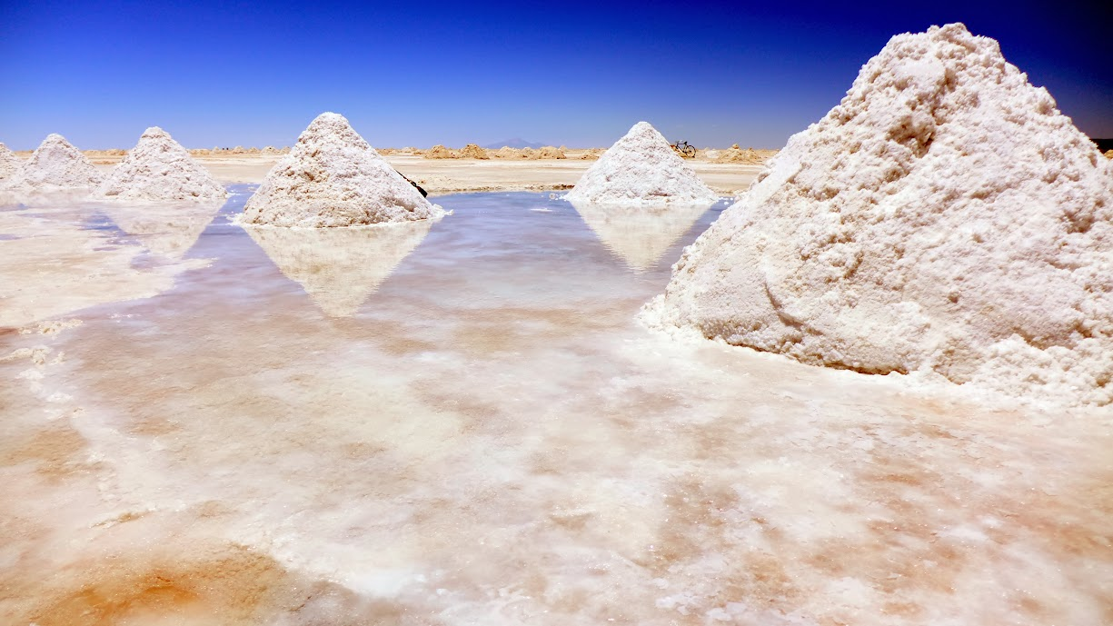 Salt mounds gathered for processing.