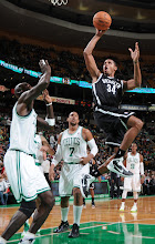 Photo: BOSTON, MA - OCTOBER 16:  Carleton Scott #34 of the Brooklyn Nets shoots the ball against Kevin Garnett #5 of the Boston Celtics on October 16, 2012 at the TD Garden in Boston, Massachusetts. NOTE TO USER: User expressly acknowledges and agrees that, by downloading and or using this photograph, User is consenting to the terms and conditions of the Getty Images License Agreement. Mandatory Copyright Notice: Copyright 2012 NBAE  (Photo by Brian Babineau/NBAE via Getty Images)