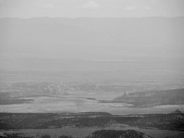 Hazy, black and white shot showing Price and Pinnacle Peak