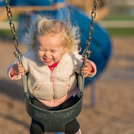 Flying on the Swings by Andrew Christmann - Babies & Children Children Candids ( playground, laughing, family, swings, kids, kid )