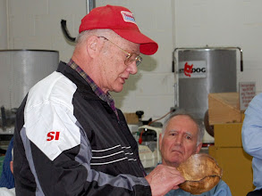 Photo: Bob Grudberg talks about his natural edged bowl that he purchased in a group buy of an Australian Myrtle wood.