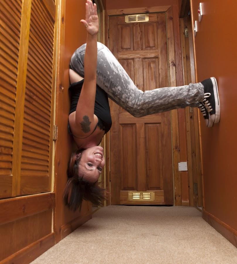Walking  the wall by Scott Mccracken - People Portraits of Women ( fun, kidult, upside down )