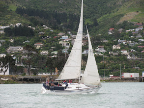 Photo: Good Point, Port Tack, close hauled,  racing on a Wednesday night, Lyttelton Harbour. Phil at the tiller, 1st place on handicap that night. We won a bottle of rum
