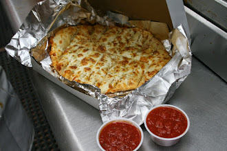 Photo: Pino`s Pizza`s famous cheesy breadsticks, with cold spicy pizza sauce for dip.