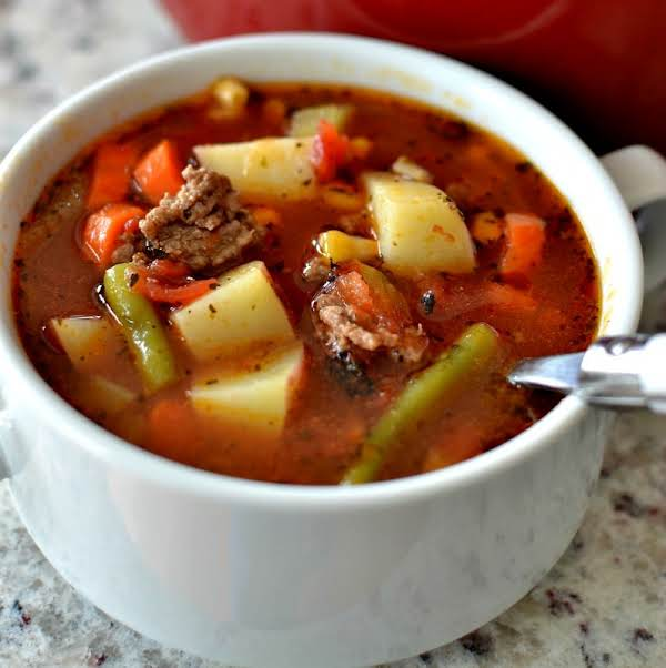 Easy Hamburger Vegetable Soup Is Family Friendly, Super Simple And Good Anytime Of The Year. It Is The Perfect Blend Of Ground Beef And Garden Fresh Vegetables. I Love To Serve This With A Warm Crusty Baguette Or Cheddar Drop Biscuits With Chive Butter.