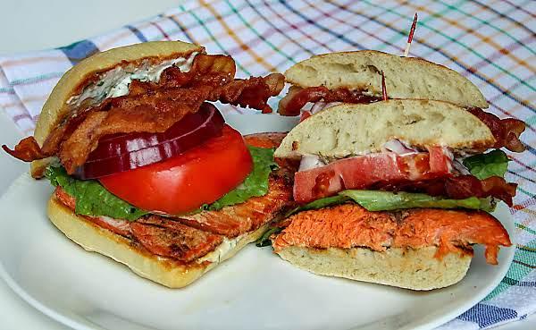 Salmon Club Sandwich With Dill Caper Aioli On A Plate.