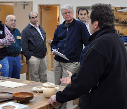 Photo: Members discuss Neil's carving