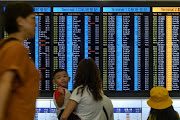 At least 16 flights were cancelled, the airport's website said, with the departure hall packed with a backlog of passengers who had struggled to make it to the terminals.