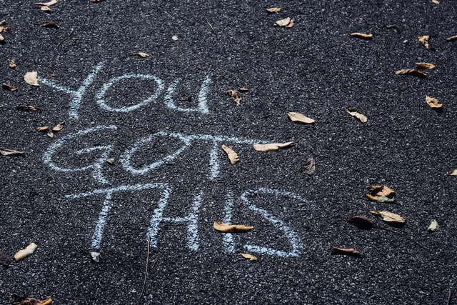 """You got this"" written with chalk on the asphalt for Earth Hour"