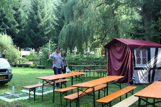 """Photo: tables and chairs, also in the """"artists village"""""""