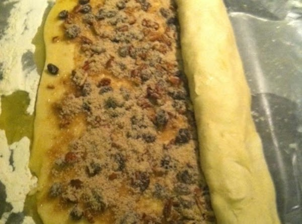 Start rolling the filled dough up by Long section. Pinch the end to seal...