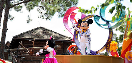 Photo: The master of ceremonies, Mickey Mouse and his girl Minnie lead the parade on by in the Celebrate a  Dream Come True Parade in the Magic Kingdom.