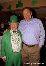 Photo: The Leprechaun (Tom Richards) and Kemah Mayor Matt Wiggins at Amadeus Italian Restaurant & Bar.