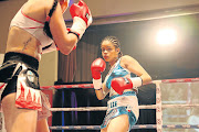Slain Leighandre 'Baby Lee' Jegels  in action against Liliana Gonzalex from Argentina at the Orient Theatre in East London.